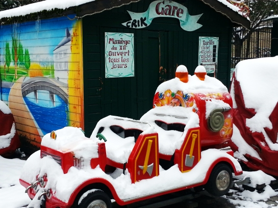 This is an adorable little children's attraction in Paris, 12th district.  The sign says, Attraction open every day.  Don't think they envisioned this snow storm either.Bellanda ®
